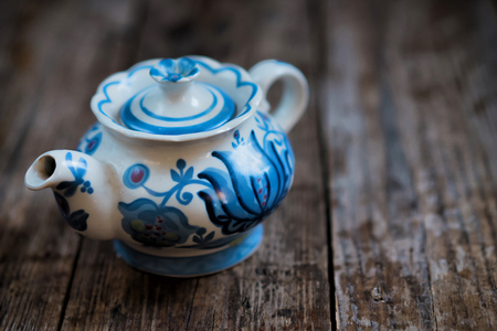 chinese teapot: Blue chinese teapot on wooden background,