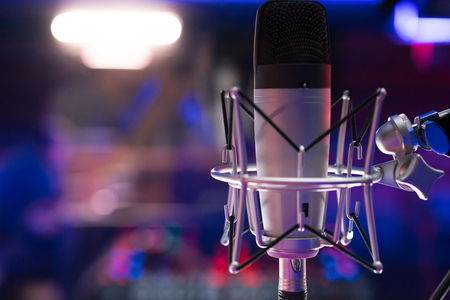 A microphone near the DJ console in night clubs, workplace.