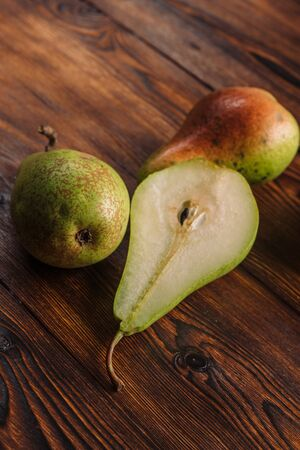 Fresh pears on the wooden background with free space for text. Top view