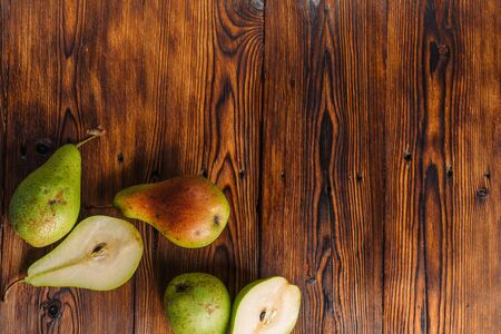 Fresh pears on the wooden background Stock fotó