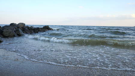 Sea waves over a sandy beach, tourism, vacation concept
