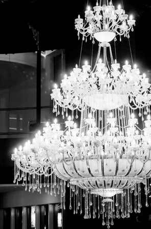 opulent chandelier with 3 levels on intricate crystal work  Suspended from the celing for a royal look