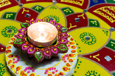 Lamp  diya  that is lit to celebrate Diwali  Lighting the lamp is a symbol of victory over darkness  evil  and bringing good into our lives  photo
