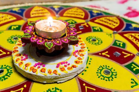 rangoli: Lamp  diya  that is lit to celebrate Diwali  Lighting the lamp is a symbol of victory over darkness  evil  and bringing good into our lives  Stock Photo