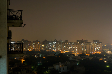 Housing buildings in Gurgaon Haryana  Apartment complexes and other buildings comprise the skyline of gurgaon photo