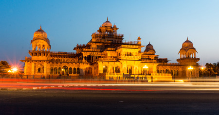 Light streams from traffic on the busy road in front of the Royal Albert hall museum in Jaipur. The museum is situated in Ram Niwas bagh which is a busy throughfare