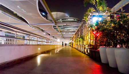 gurgaon: Gurgaon, India- 2nd July 20l4; lit walkway at cyberhub gurgaon  The walkway has a number of restaurants where visitors can enjoy the choicest cusine