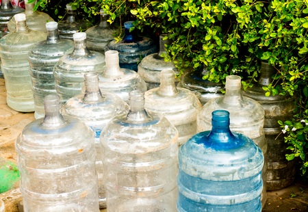rely: Empty damaged plastic water bottles  Many indians do not have access to clean drinking water an must rely on locally bottled water for consumption