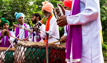local festivals: Delhi, India; 10th Aug 2014 - Traditional north indian musicians playing local instruments. The colorful dresses are traditionally worn during festivals or when performing