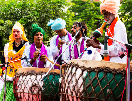 gurgaon: Delhi, India; 10th Aug 2014 - Traditional north indian musicians playing local instruments. The colorful dresses are traditionally worn during festivals or when performing