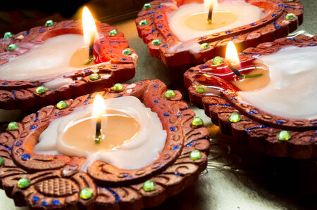 diyas: Lit earthenware wax diyas. These are handmade and lit to celebrate the hindu festival of Diwali Stock Photo