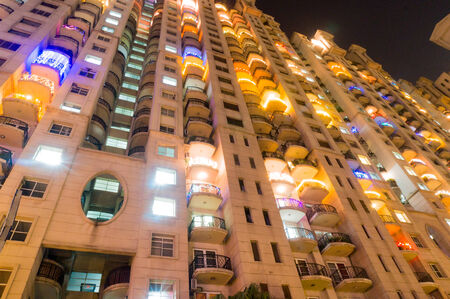 modernization: High rise apartments in Gurgaon India beautifully lit up for the festival of diwali. The developement of Gurgaon has seen the construction of a number of skyscrapers for housing Editorial