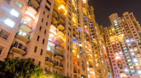 gurgaon: High rise apartments in Gurgaon India beautifully lit up for the festival of diwali. The developement of Gurgaon has seen the construction of a number of skyscrapers for housing Editorial