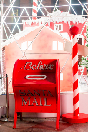 gurgaon: letter box for santas mails set to a background of candy canes and houses