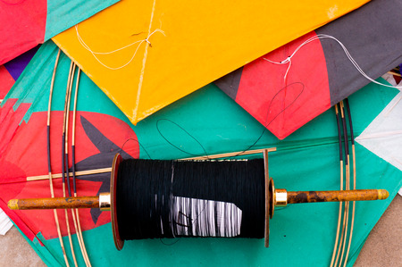 paper kites: Colorful paper kites and string used in the sport of kite fighting. The special string is covered in glass to make it sharp. Traditionally flown on Makar Sankranti or on Republic day