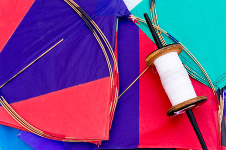kites: Colorful paper kites and string used in the sport of kite fighting. Traditionally flown on Makar Sankranti or on Republic day Stock Photo