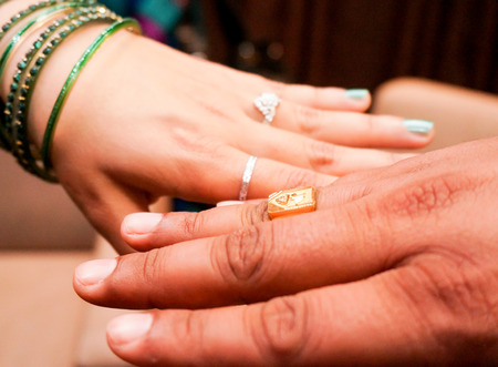 bangles hand: Indian bride and groom wearing the engagement or wedding rings.