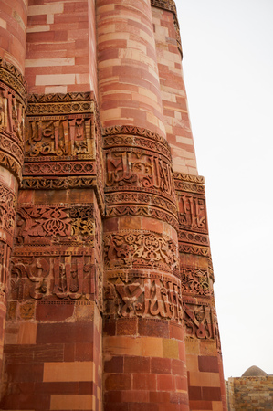 mughal architecture: Carving details, beautiful patterns on the outside walls of Qutub minar in Delhi