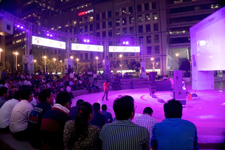 gurgaon: Gurgaon, India; 5th Nov 2014: Crowd watching a live performance at the amphitheater at cyberhub gurgaon. Regular events at cyberhub are a great attraction for the young crowd Editorial