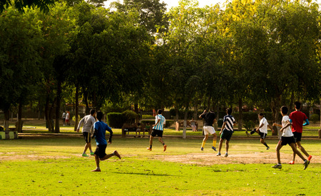 gurgaon: Gurgaon India  23rd May 2015: Peopel playing football in a park in Gurgaon Haryana. People are increasingly opting for more healthy activities