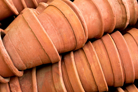 neatly stacked: Neatly stacked clay flower pots used for gardening