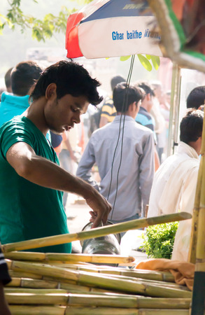 gurgaon: Delhi India 7th Jun 2015: Vendor running a sugarcane juice business in Gurgaon Delhi India. Such roadside stalls are extremely popular in the hot summers