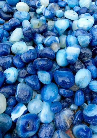 Blue stones with interesting patterns used for decoration or construction. Can be used as a background or abstract shot