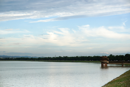 destress: Sukhna lake in chandigarh with rain clouds over it during evening. The tower on the lake is visible