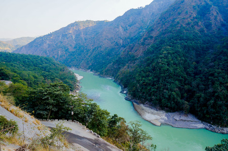 aisa: Himalya mountain range with the Ganges flowing through it. This is further up in the mountains from Rishikesh and is a popular tourist destination