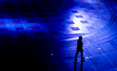 people shadow: Silhouette of a walking man in blue light. Symbolizing the lonely journey through depression with no help or support