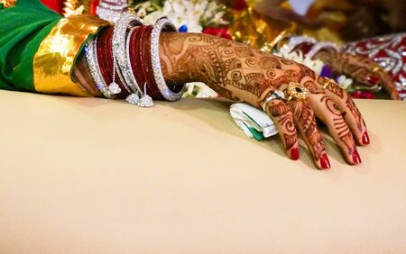 bangles hand: Indian brides hand with mehndi, rings and bangles for wedding ceremonies Stock Photo