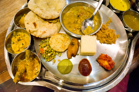 Set of north indian delicacies spread out for a celebration dinner.