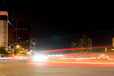 gurgaon: Modern buildings in Gurgaon with light trails from traffic