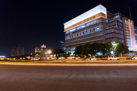 gurgaon: Gurgaon, India; 19th Sept 2015: Modern office building in Cyberhub Gurgaon delhi with cars parked in front Editorial