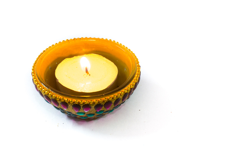 diya: Diya lamp beautifully decorated with paint and jewels and isolated on white