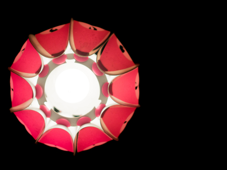 opulence: Isolated paper lantern with an interesting pattern and lit from within. These are used as decoration on diwali, christmas and new year