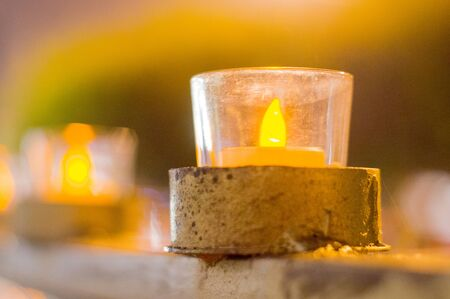 diya: Glass and wood diya lamps against a colorful out of focus background. These are traditionally used as decorations on Diwali, the indian festival of lights
