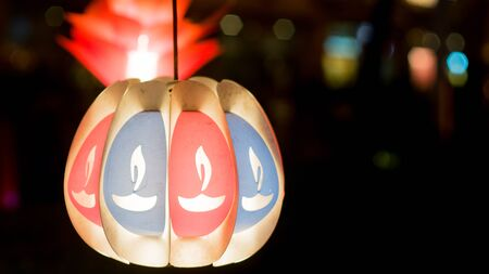 diyas: Isolated paper lantern with hand painted diyas on the sides. These lanterns are traditional decorations put up on diwali and christmas.