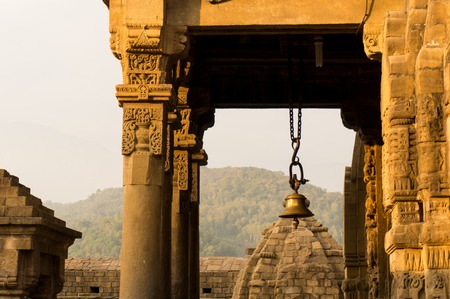 shiva: Bell and pillars at the entrance to the Shiva temple at Baijnath in India. This is a very popular tourist destination in Himachal Pradesh india Stock Photo
