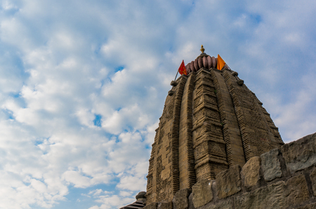 spire: Spire and carvings of the ancient hindu temple dedicated to Shiva at Baijnath in Himachal India. This is a popular tourist destination.