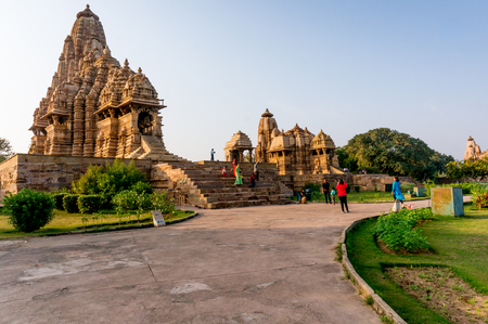 madhya: Khajurao, India, 6th Dec 2015: well laid out and green temple complex in the ancient city of Khajurao India. The complex complements the beautiful hindu jain temples Editorial