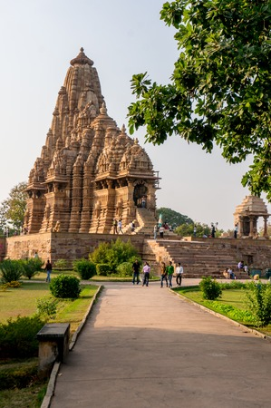 well laid: Khajurao, India, 6th Dec 2015: well laid out and green temple complex in the ancient city of Khajurao India. The complex complements the beautiful hindu jain temples Editorial