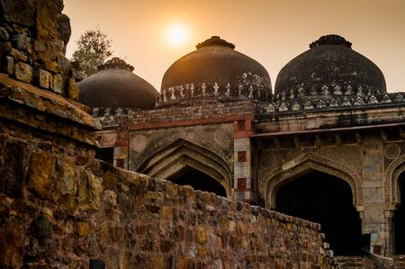 mughal architecture: Ruins of Lodhi garden delhi at sunset. This is mughal architecture at its finest with domes and arches