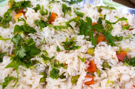 comfort food: The Indian vegetable pulao is rice seasoned with vegetables and spices and is a healthy comfort food served with many meals Stock Photo