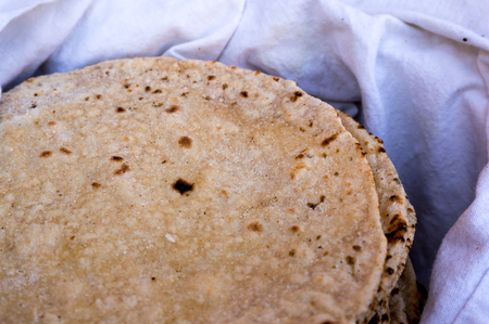 punjab: Indian flatbread or roti kept on a white cloth. This traditionally accompanies every north indian meal and is the main staple Stock Photo