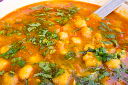 punjab: Indian dish of potatoes in a gravy garnished with coriander leaves and eaten with flat bread, roti.