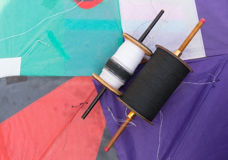 paper kites: colorful indian paper kites and spool for the sport of kite fighting on Makar Sankranti or independence day.