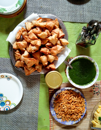 sev: Indian snacks of Samosa, chutney and namkeen set to be served in lunch dinner or snacks