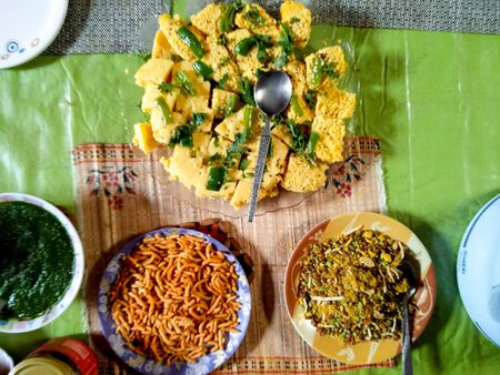 sev: Indian dish of Dhokla, chutney and namkeen ready to be served for lunch dinner or snacks