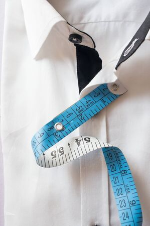 perfect fit: High key white shirt with measuring tape showing fitting, design, perfect fit and tailoring